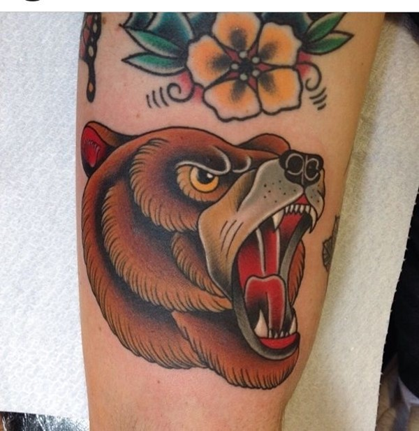 Awesome Brown Ink Bear Head And Yellow Flower Tattoo For Sleeve