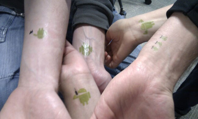 Nice Matching Android Green Ink Tattoo On Wrist For Friends