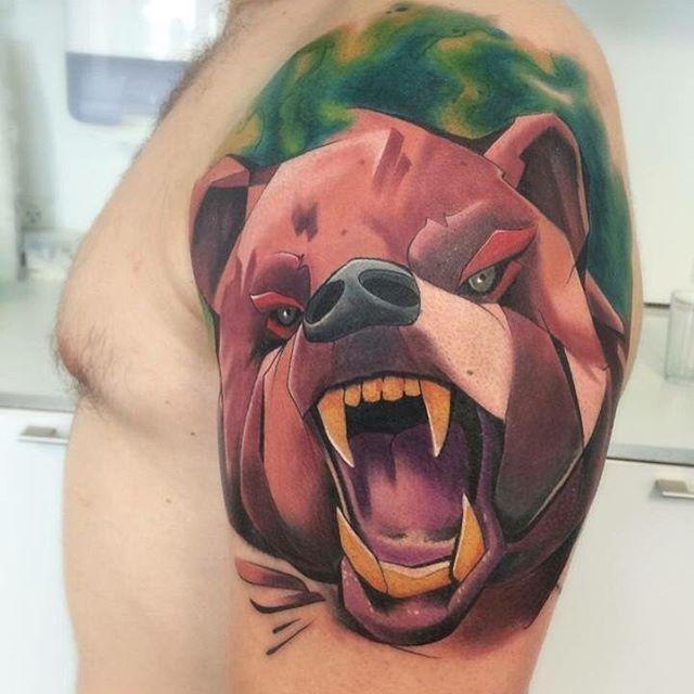 Outstanding Brown Ink Aggressive Bear Face Tattoo Design On Men Shoulder
