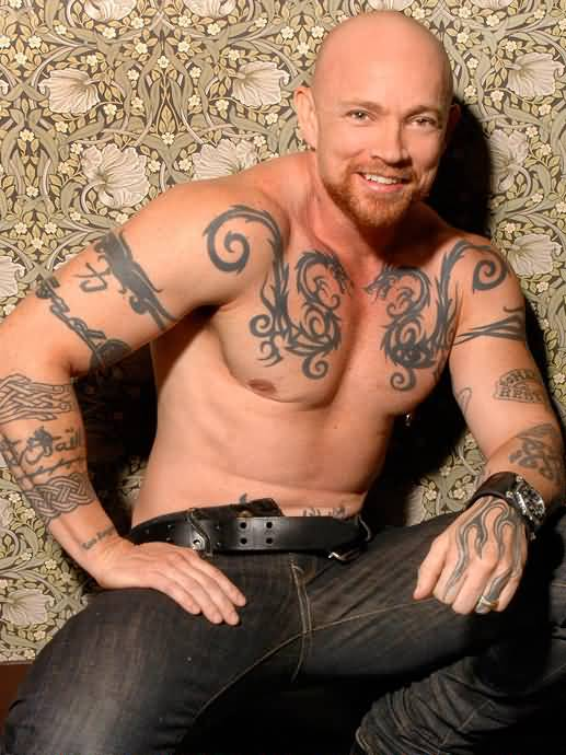 Smiling Buck Angel Showing Body