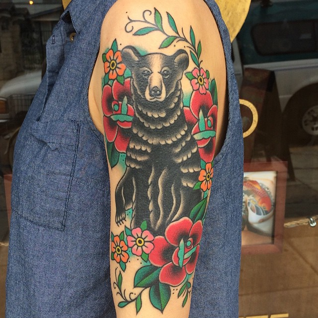 Mind Blowing Black Bear With Flower Vine Tattoo Design On Men Sleeve