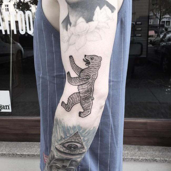 Most Amazing Simple Grey Ink Bear Third Eye Tattoo On Men Sleeve