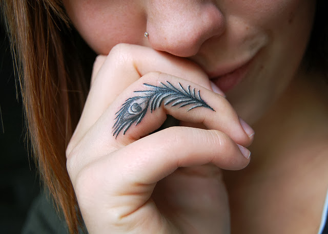 Ultimate Peacock Feather Tattoo On Girl Ring Finger